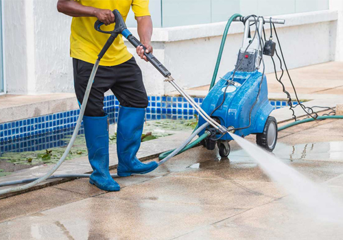 Maintenance and cleaning interior courtyard of a house.